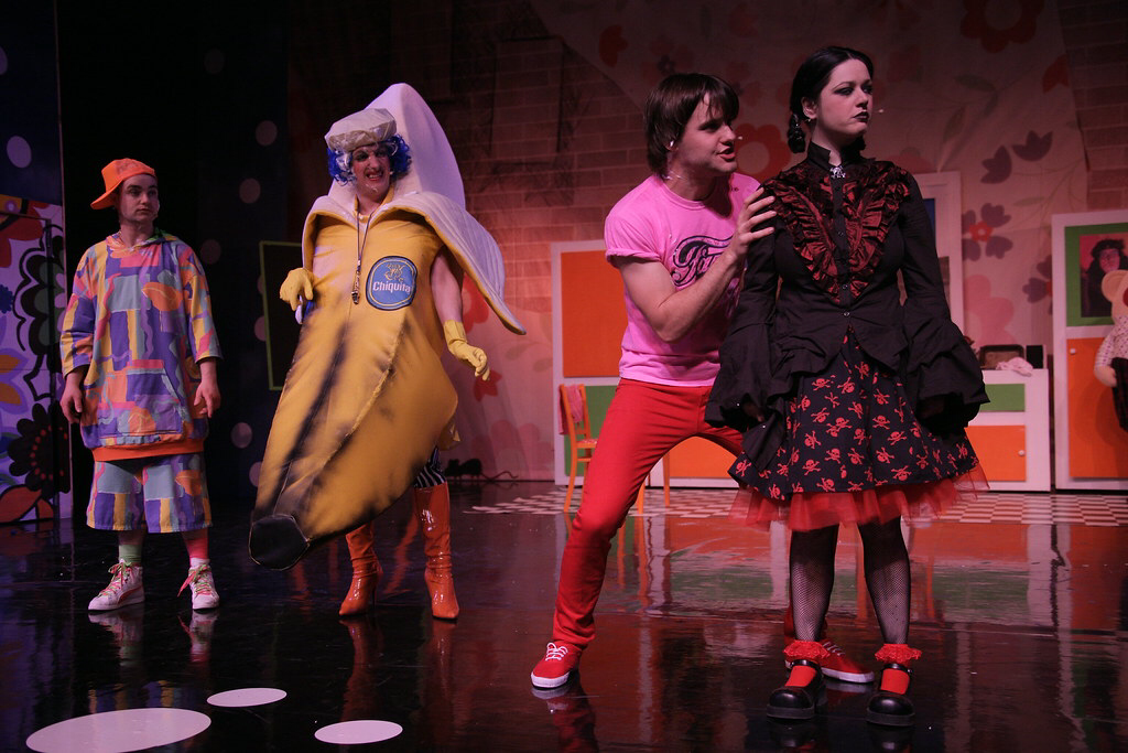 Johnny McKnight wears a large banana costume during a slapstick scene with 3 other actors on stage at the Macrobert Arts Centre.
